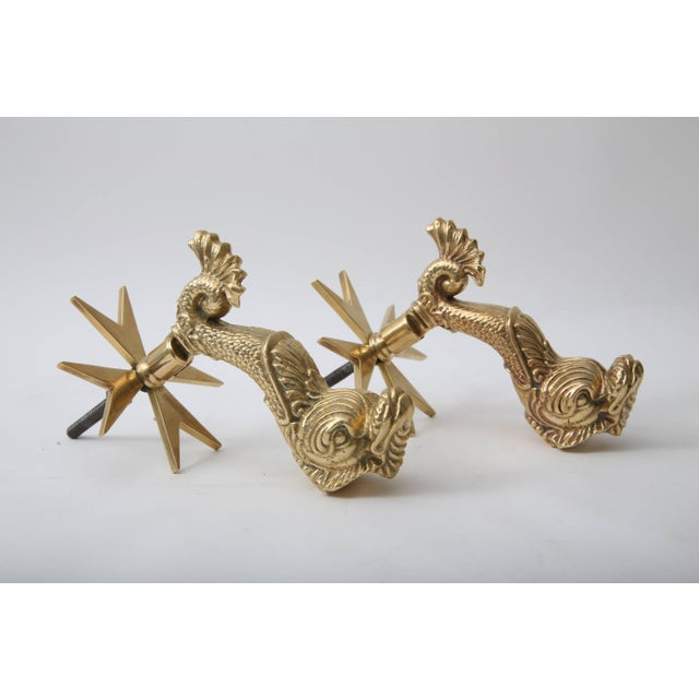 This set of solid brass, dolphin-form door knockers were produced by the Cutjar Works of Malta and have been...