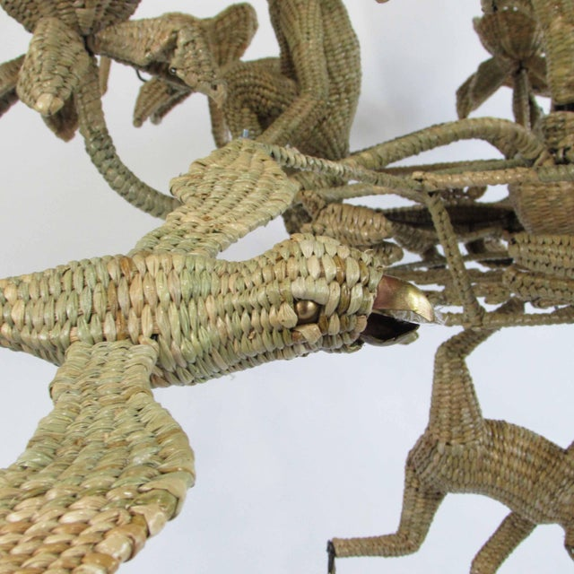 Woven RATTAN Mario Lopez Torres Parrot Toucan Monkey Chandelier in nice condition. There are minor scuffs, scrapes, wear...