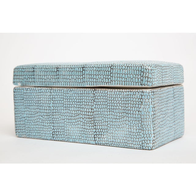This chic glazed porcelain 2 part box has a raised textural pattern like snakeskin pebbled. It is the color of turquoise...