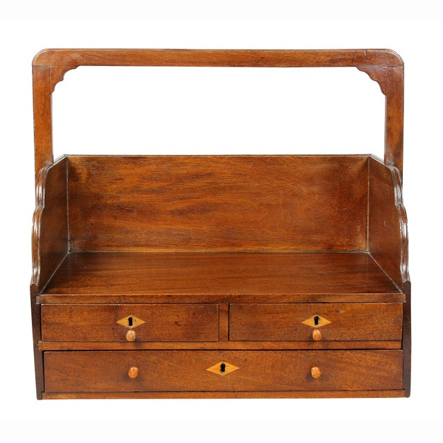 With handle and rectangular top over two short and a long drawer. Inlaid escutcheons. Drue Heinz Estate.