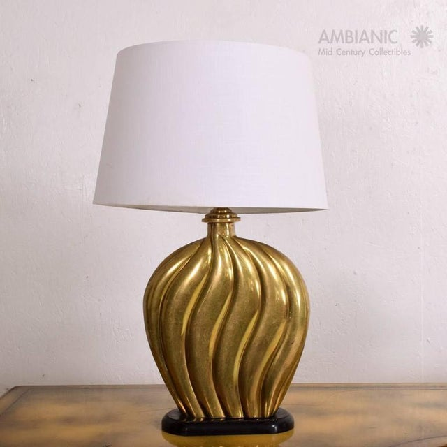 For your consideration a vintage table lamp in cast brass/ bronze-mounted a wood base (painted in black). Lamp has been...