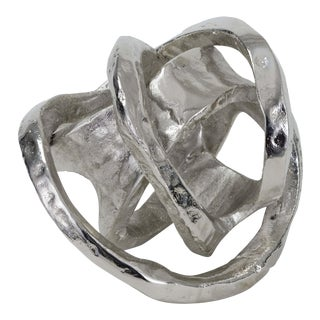 Metal Knot in Polished Nickel For Sale