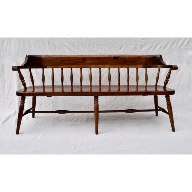 Solid pine farmhouse bench or settee with curved, spindle back in excellent vintage condition. An heirloom quality piece...