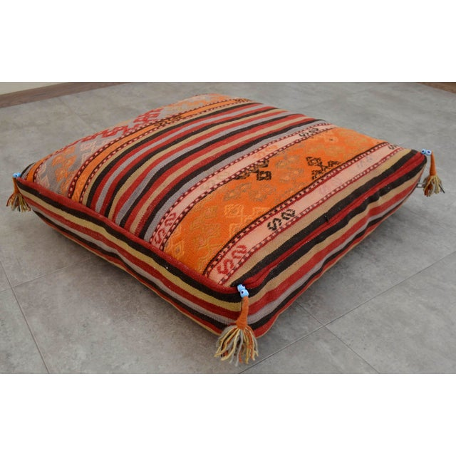 This is a hand woven Turkish kilim floor pillow cover made from a wool on wool hand woven vintage rug. Note : Insert in...