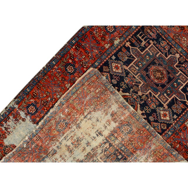 Antique hand-knotted Persian Heriz Rug with a floral design. This piece has great detailing and a beautiful design, it...