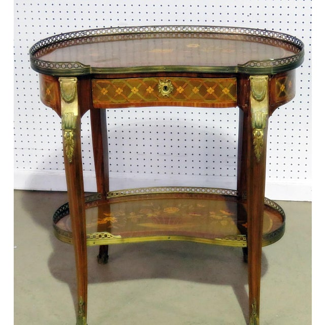 Louis XV style intricately inlaid 1 drawer accent table with a brass gallery and mounts.