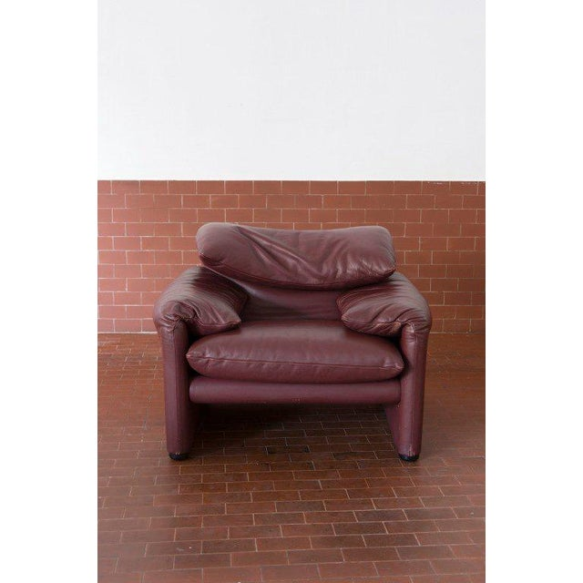 Couple of Armchairs with Ottoman by Vico Magistretti for Cassina, in dark red leather.