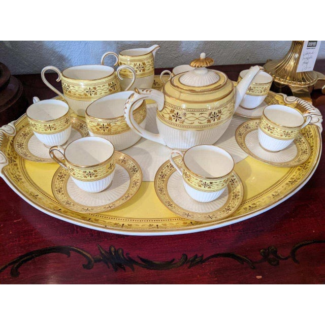 An eye-catching lovely large set of Bailey Banks and Biddle tea set in a happy yellow and white and gold leaf. Includes 5...