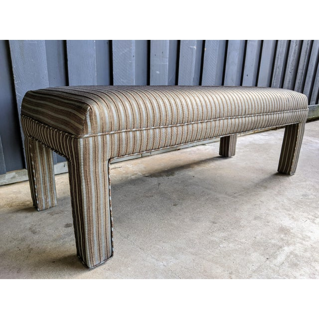 A great parson's style bench from the 1980s, upholstered in a high quality, excellent condition striped, textured...