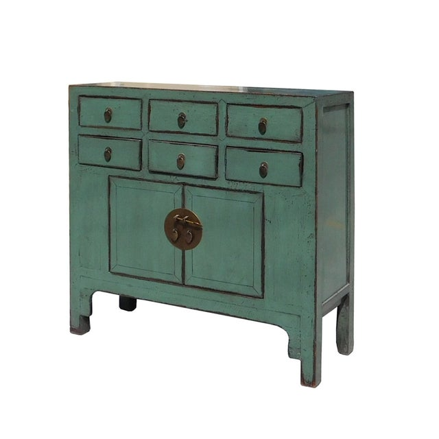 This is a high credenza cabinet table with gray blue lacquer surface finish. There are 6 drawers for storage and a...