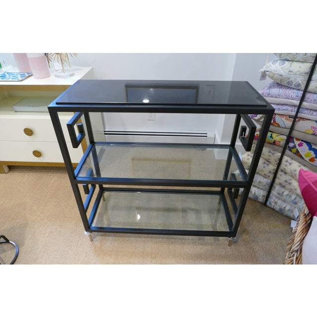 Greek key bar cart featuring three shelves made of black painted steel. Features two tiers of removable glass shelves,...