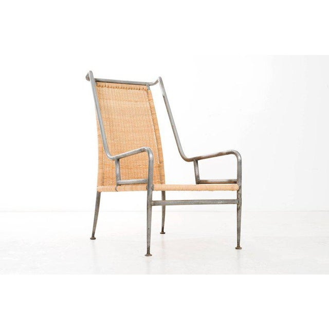 ARTURO PANI (1915 - 1981) High back 'prototype' rattan lounge chair with a magnesium/ aluminum frame. Executed by Talleres...