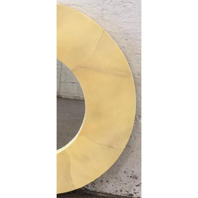 Round goatskin mirror in the style of Karl Springer.
