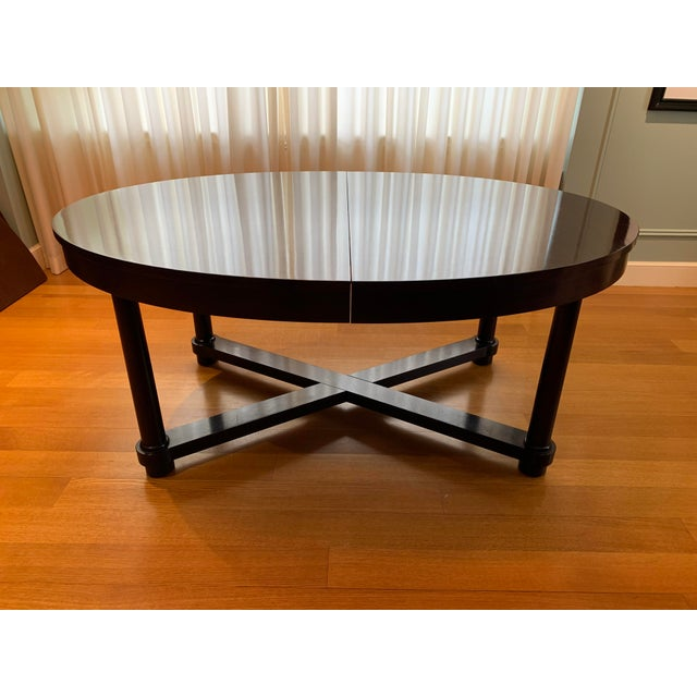 The Barbara Barry Collection for Baker. Baker mahogany ambassador oval dining table features gorgeous, rich mahogany,...