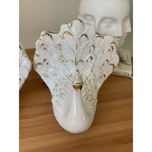 A set of stunning porcelain and gold swan vases with multiple vase holes. Amazing pair never seen anything similar before....