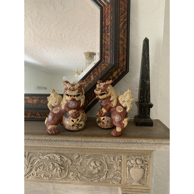 Pair of bright, exotic foo dogs. Signed. Vintage, possibly antique. Foo dogs offer protection against bad feng shui. Every...