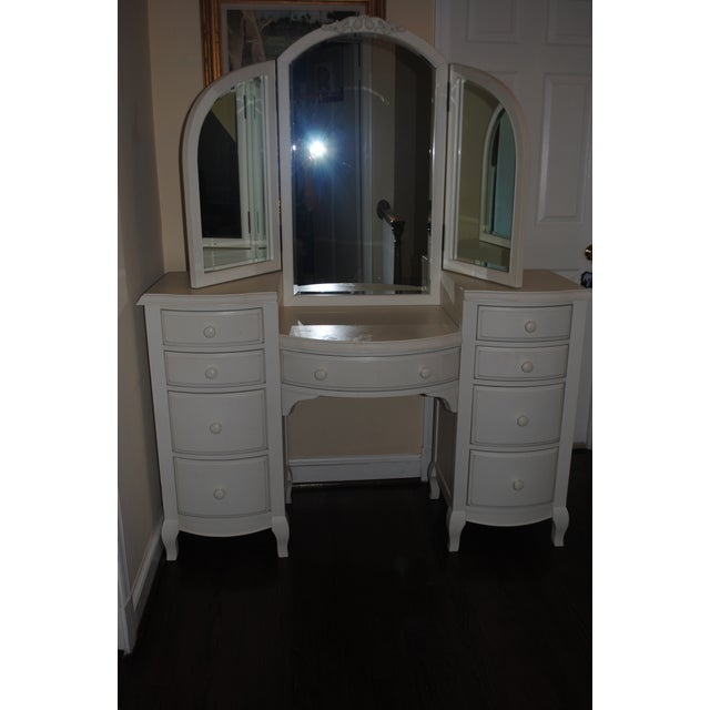 Offered is a contemporary vanity, crafted with a kiln-dried hardwood frame. A partitioned center drawer keeps your...