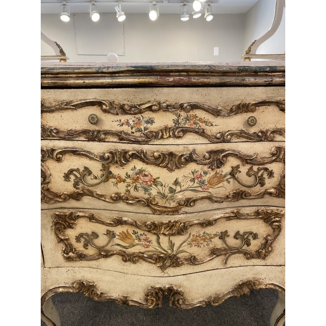 This is a gorgeous Italianate chest. The serpentine bombe' form with faux marbre top, hand painted botanicals, silver and...