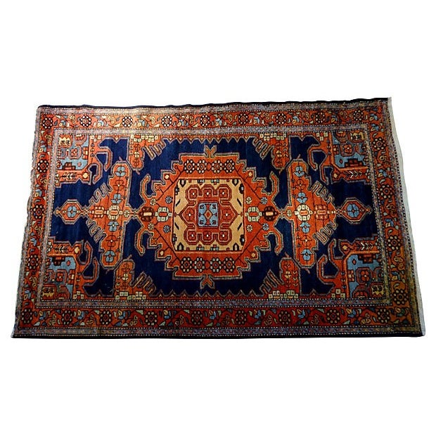 Superb circa 1930 hand-knotted Malayer rug with geometric red medallions over cobalt blue background. It also features...