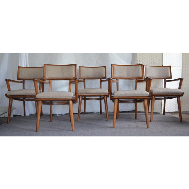 Amazing refinished and upholstery ash chairs. The chairs have multiple curved design elements, tapered legs, cushioned...