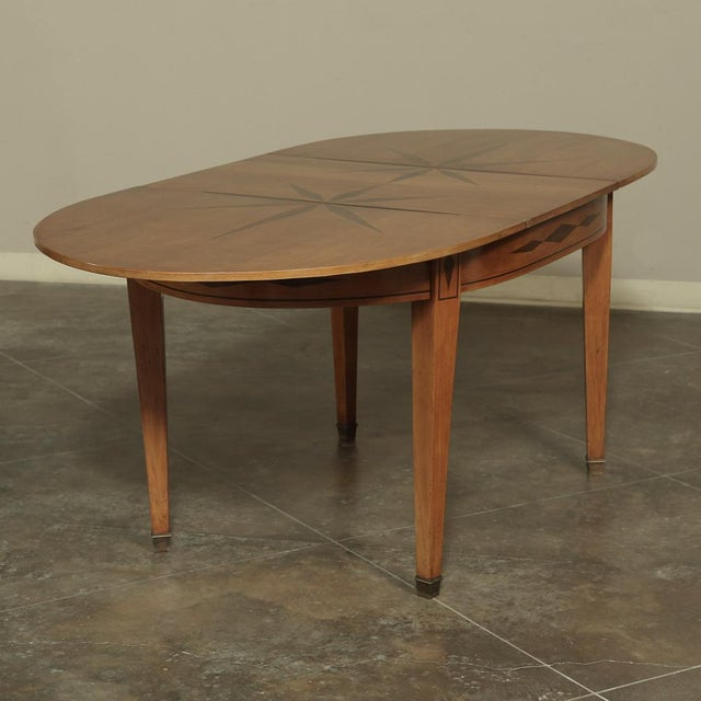 Mid-Century French Directoire Style Inlaid Table was hand-crafted from solid cherry wood with inlaid heart of French...