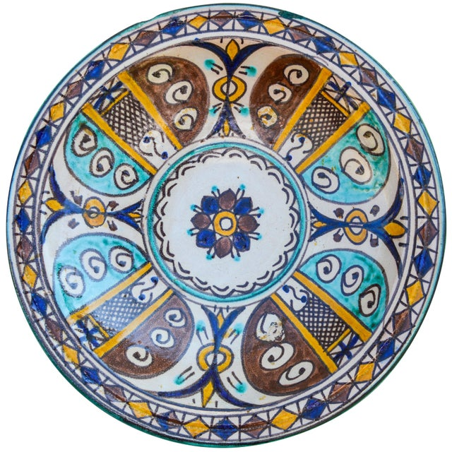 Handcrafted ceramic plate featuring an elaborate hand-painted Moorish pattern in a traditional Andalusian color...