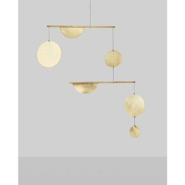 The movement of the mobile is contemplative, and the warmth of the brass feels very inviting. The mobiles are handmade...