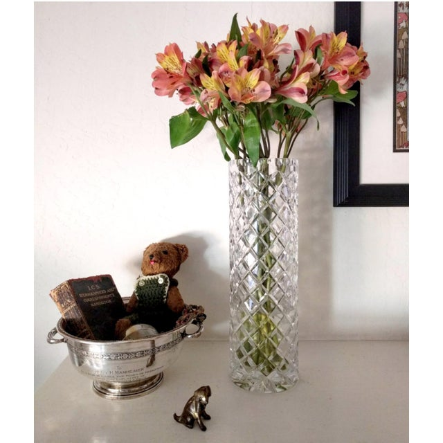 A stunning, unusually tall crystal vase perfect for long-stem roses or branches. (Please note there is no discoloration.)