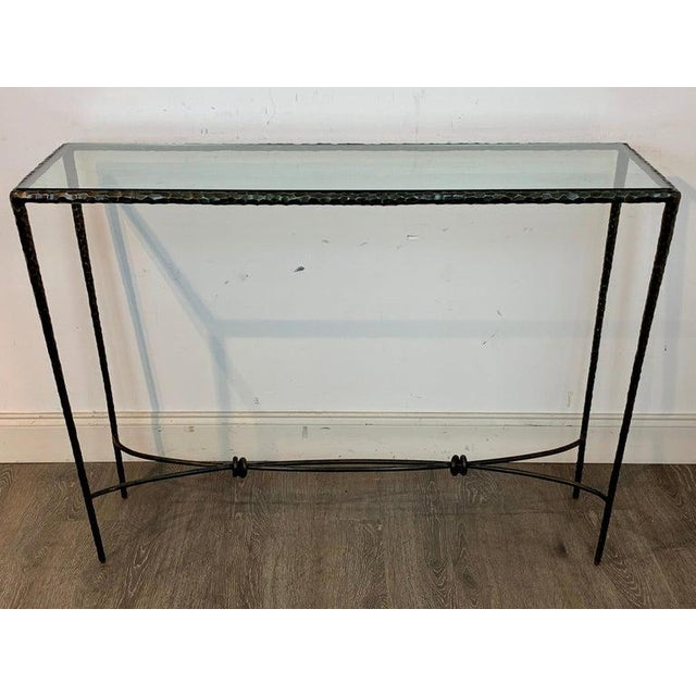 French modern cast bronze and glass console table, of rectangular form, finely cast with textured surface with inset...