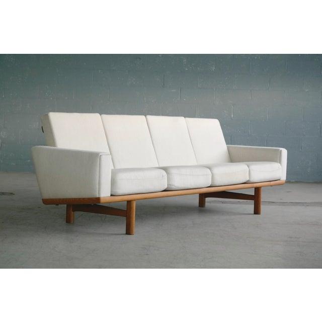 Danish Modern Hans Wegner for Getama Model Ge-236/4 Four Seat Sofa in Oak and Beige Wool For Sale - Image 3 of 11