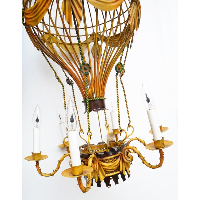 Charming & sought after vintage Italian tole hot air balloon chandelier. Whimsical antiqued yellow and green. No rust,...