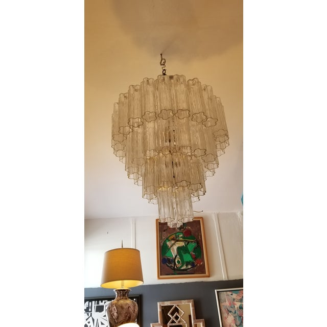 """Stunning four-tiered """"Tronchi"""" glass chandelier designed by Venini of Italy. Each of the handblown glass tubes measures 8""""..."""