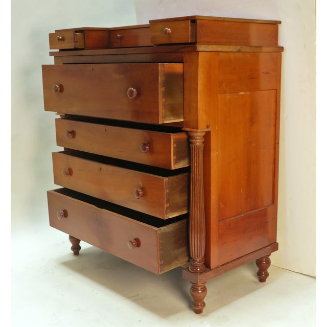 American Federal chest of drawers with four long drawers topped with a set of three small step back drawers. Lower case...