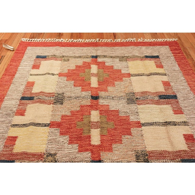 Vintage Kilim, Sweden, mid-20th century. Simple, blocked shapes set the tone throughout this attractive Kilim, keeping...