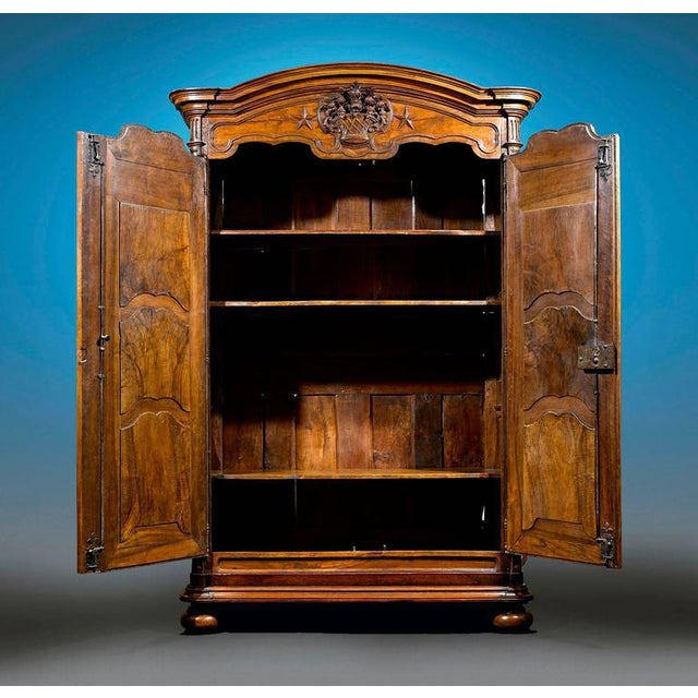 This monumental Louis XV armoire exhibits the rare beauty of French Provincial furniture. Crafted of lustrous walnut, this...