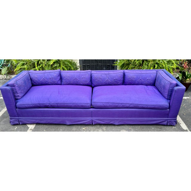 Grosfeld House Hollywood Regency Mid Century Modern 9' Low Sofa. The color is an alexandrite purple with hues of blue in...