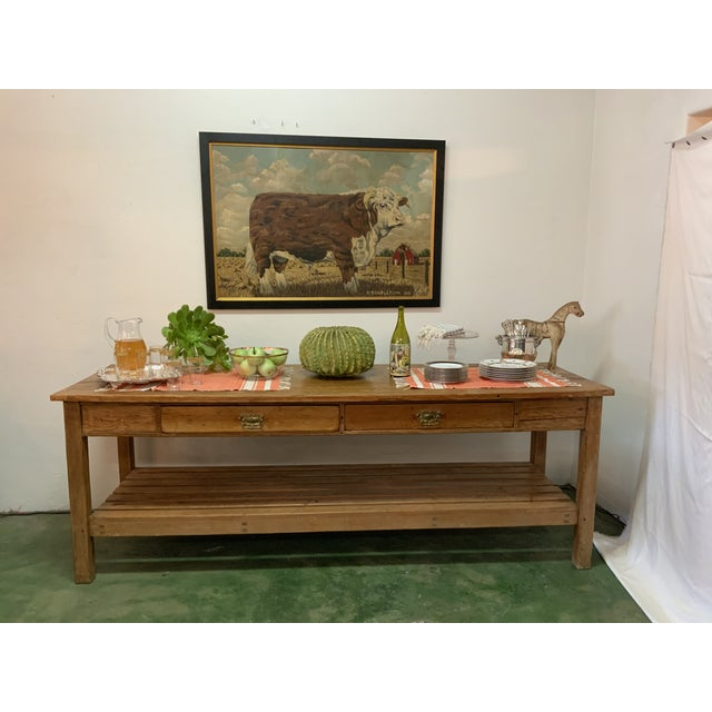 This rustic pine table / sideboard has two drawers and a lower level for ample storage. The substantial table has a rich...