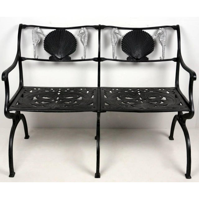 This garden settee with its seahorse and shell motif was designed and created by Molla in the 1950s. It is fabricated in...