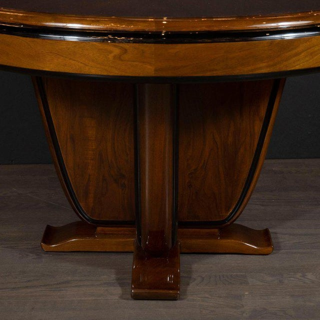 This refined Art Deco dining/centre table was realized in France, circa 1935. It features a three-tier black lacquer...
