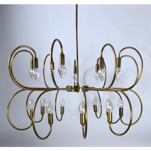 Large eighteen-light brass up and down light chandelier, in very good working, original condition. Height of fixture...