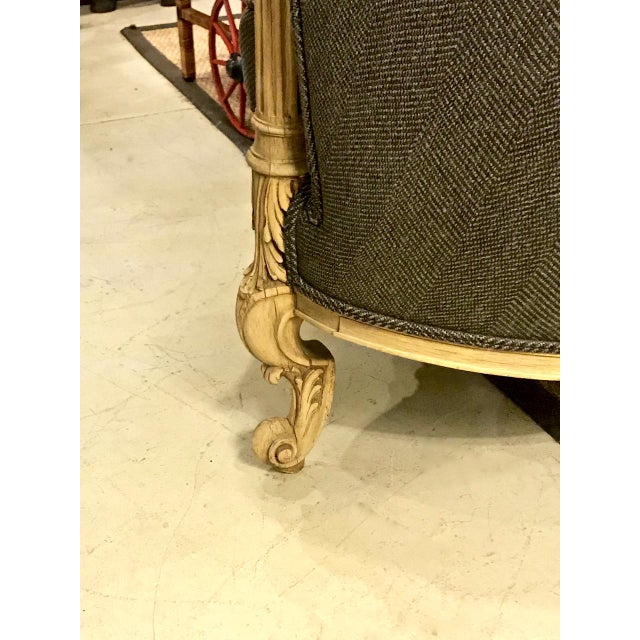 This is a very unique (funky) barrel back club chair that probably dates to the 1920s. The chair has been updated with the...