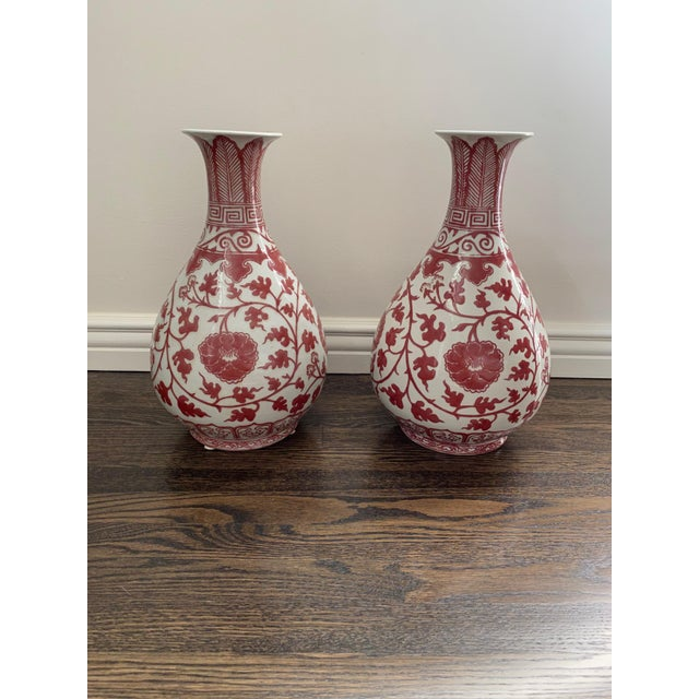 Pair of lovely soft red and white floral vases imported from Hong Kong. They look beautiful displayed on a mantel, in a...