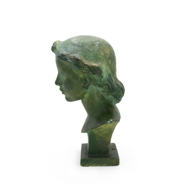 2 French Art Deco (1930s) green patina plaster busts of young women available. Signed: VADIM ANDROUSOV). Priced each. See...
