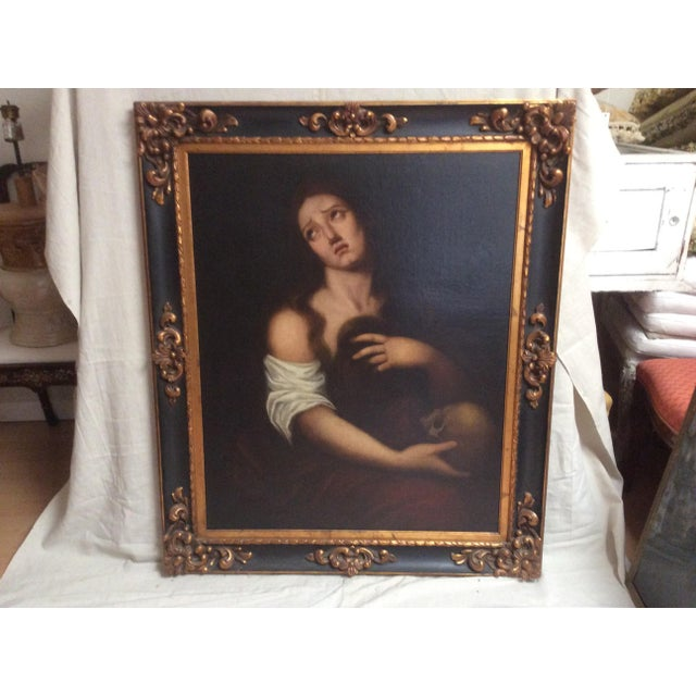 Antique oil painting with re lined canvas. This oil painting depicts a person holding a human scull.