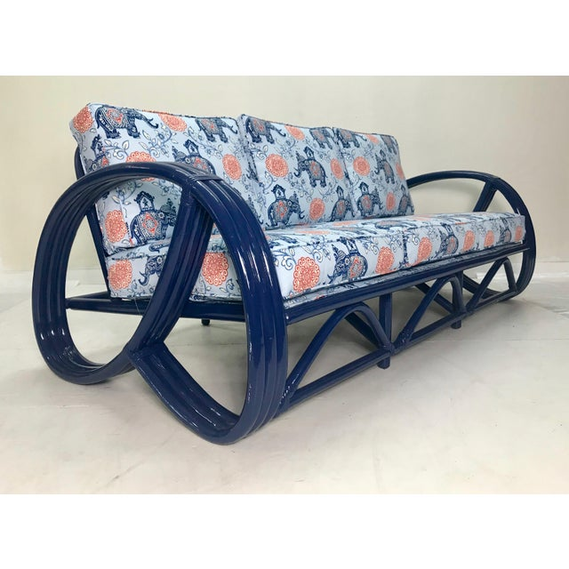 Beautiful Vintage Navy Pretzel Rattan Sofa. Professionally lacquered in Benjamin Moore's Old Navy with a High Gloss...
