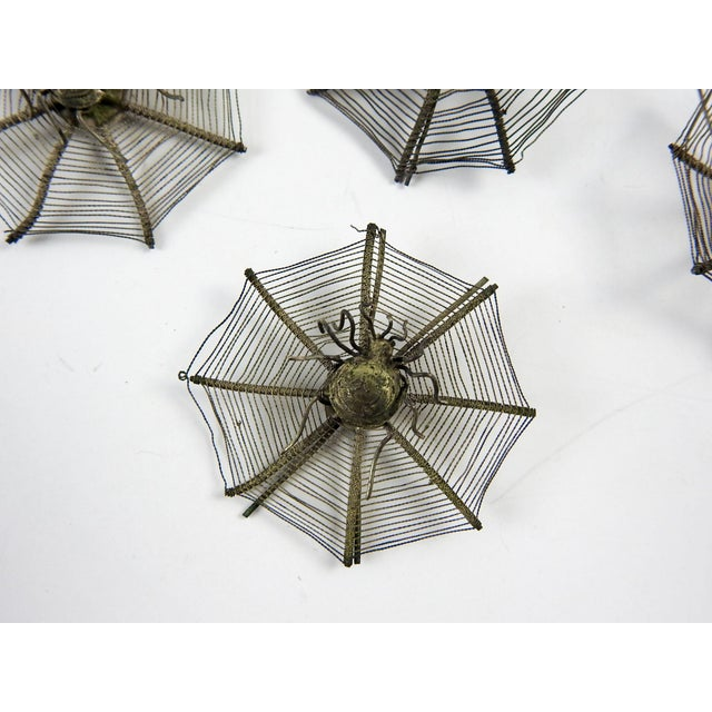 Set of 7 circa 1920's silver plate spider webs with spiders. Wire on back lets you use them to stand up for place...