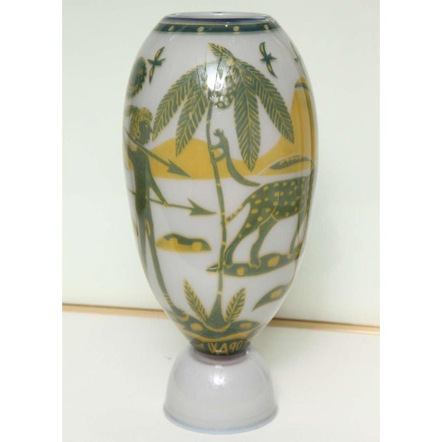 Wilke Adolfsson (b. 1940). An oblong form glass vase over a cup-shaped foot, decorated with a tropical jungle scene with a...