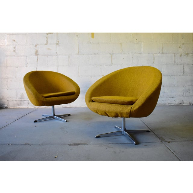 Pair of Mid Century Modern molded styrofoam chairs covered in original mustard colored tweed fabric with polished aluminum...