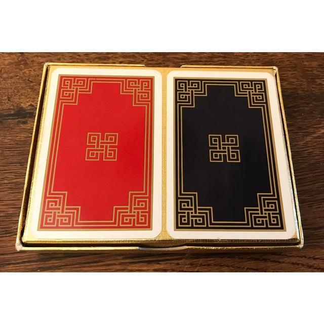 Nice double boxed set of playing cards in a blue and red Greek key design with gold trim. Lightly used.o