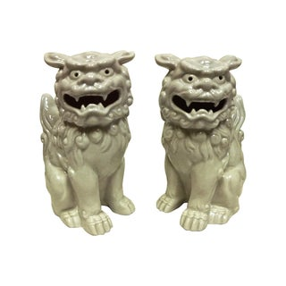 Reticulated Porcelain Foo Dogs - A Pair For Sale